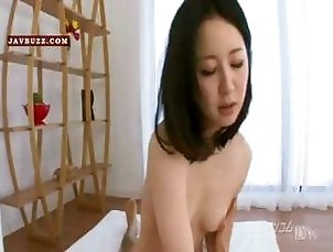 Japanese nympho makes love on a mattress in the living room