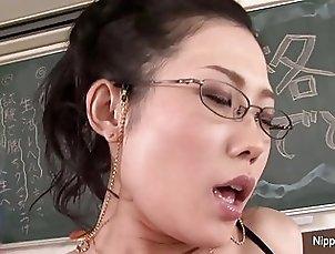 Horny Japanese teacher fucks herself in a classroom